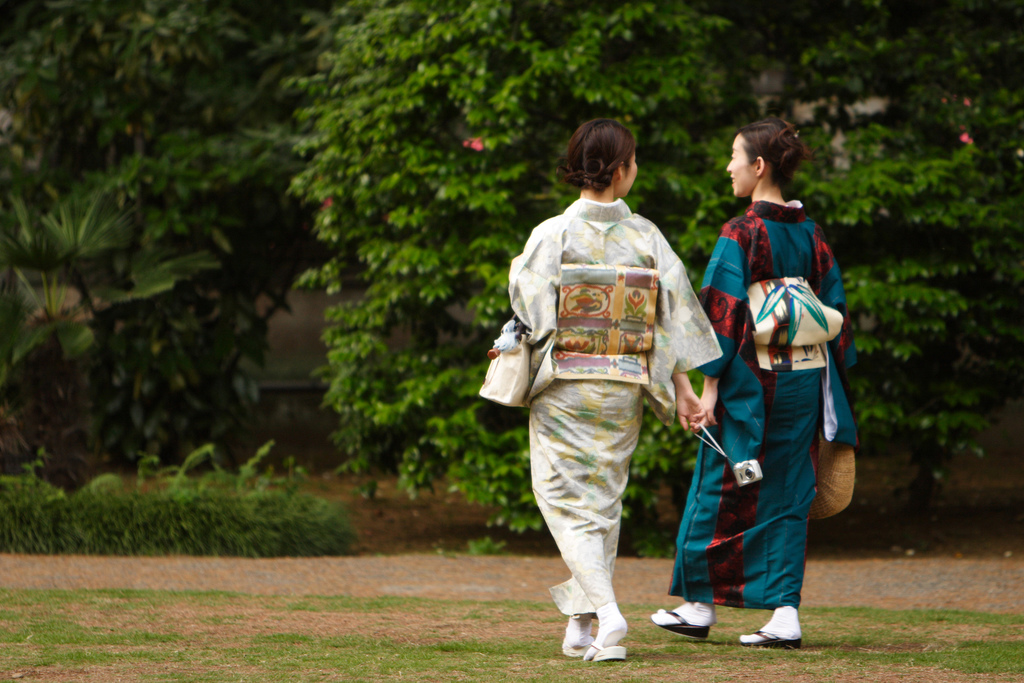 young adult women in kimonos